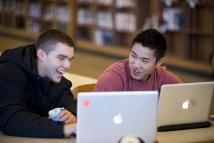 students on computers in library
