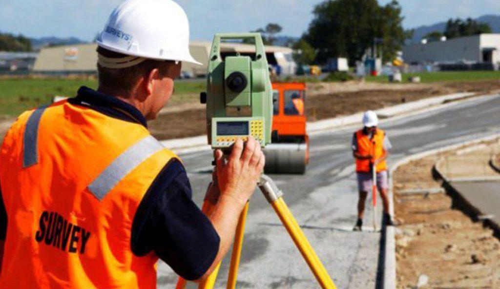 People using surveying engineering tools