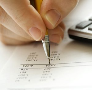 Person underlining financial information